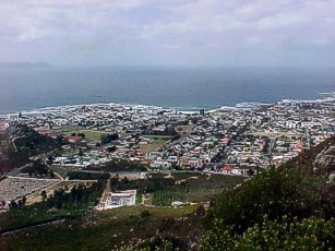 View over Hermanus, with, in the distant background, the mountain point where Gansbaai is situated.